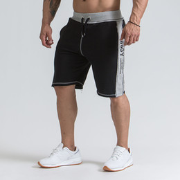 muay thai clothing NZ - Men Bodybuilding Shorts Fitness Workout 3 Inseam Bottom Cotton Male Fashion Casual Short Pants Brand Clothing MMA Muay Thai
