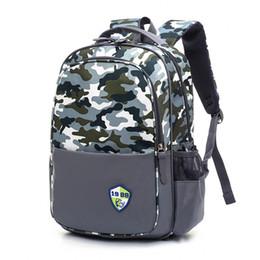 Waterproof children school bags Girls Boys Kids Satchel Orthopedic  schoolbags Camouflage primary school backpack mochilas infant 6717e04f8a