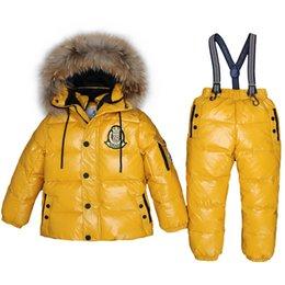Ingrosso 2017 ragazze ragazzi inverno -30 gradi giù vestiti per esterni set di spessore antivento bambini 2-9 t cappotti con cappuccio + tute set neve russa