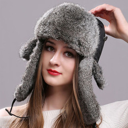 0b49e241844 Winter Women Men s Hats Natural Rabbit Fur Bomber Hat with Ear Flaps  Waterproof Cloth Tops Russian Warm Fur Hats for The Winter
