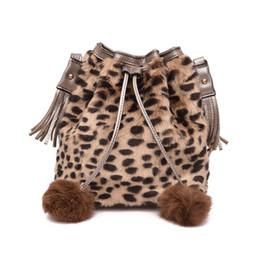 $enCountryForm.capitalKeyWord Canada - Fashion Design Faux Fur Bucket Drawstring Bag Leisure Handbag Women Leopard Fluff Crossbody Tassel Hairball Decoration Bags O bag