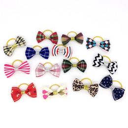 Großhandel Mixed Hair Bows Gummibänder Candy Farben Mode niedlichen Hund Welpen Katze Kätzchen Haustier Spielzeug Kind Fliege Krawatte Kleidung Dekoration