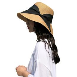 China 2018 Fashion Women Bow Straw Hat Wide Brim Solid Summer Beach Sun Cap Floppy Trilby Hat Khaki Sun for Women Girls Hats supplier straw hat trilby suppliers