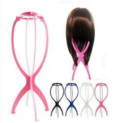 Venta al por mayor de La más nueva de la peluca Stands Plástico estable sombrero gorro pantalla Durable peluca herramienta de soporte accesorios para el cabello negro color rosa