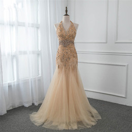 evening gown belt sashes NZ - 2018 Elegant Halter Golden Organza Floor Length Rhinestones Evening Dress Sexy Backless Sleeveless Mermaid Prom Gowns Pearls Belt Party Gown