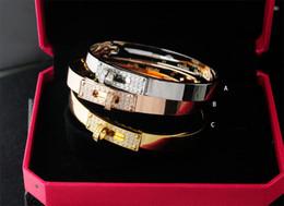 $enCountryForm.capitalKeyWord Australia - linlin Factory Sell Good Quality Celebrity design Letter Metal Belt Rivets bracelet Fashion Letter Metal Buckle bracelets With Box