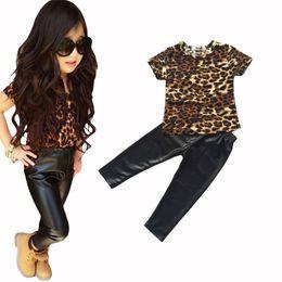 $enCountryForm.capitalKeyWord NZ - Retail New baby fashion cool kids girls clothes set Leopard printed T-shirt PU skinny leather pants legging 2 piece set