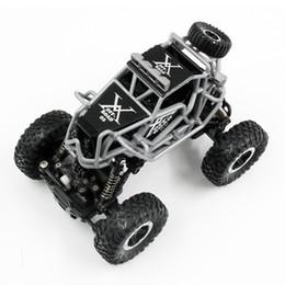 Fronteriza 1:43 mini vehículo de escalada 2.4 G de cuatro ruedas motrices control remoto todo terreno 1 carro de juguete modelo recargable