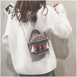 $enCountryForm.capitalKeyWord Canada - New tassel chain zipper handbags women shoulder messenger crossbody bags lady fashion casual totes orange blue color no942