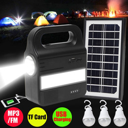Solar Panel Charge Usb NZ - Smuxi 1Set Solar Lighting System Generator USB Charging Rechargeable Lamp MP3 FM Camping Power Supply With 1xSolar Panel 3xBulb