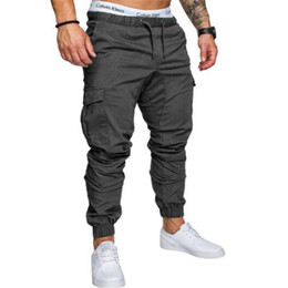 2018 Марка Мужские брюки хип-хоп брюки-карго мужчины бегуны брюки Мужские твердые мульти карман тренировочные брюки эластичный пояс брюки 4XL на Распродаже