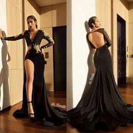 595cc00969c7 Black Mermaid Shape With Gold Applique Lace Evening Dresses 2018 Long  Sleeves Thigh Slit Side Backless Prom Gowns