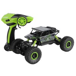 Battery Charging Units UK - 2.4G four-drive bigfoot cross-country climbing car rechargeable remote control car boy model toy car children's toy
