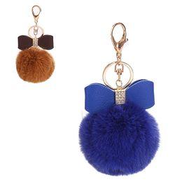 Big Ladies Handbags Australia - 8CM Big Faux Fur Plush Ball Keyrings for Women Bowknot Key Chain Rhinestone Keys Ring Lady Girl Handbag Pendant Car Keychain
