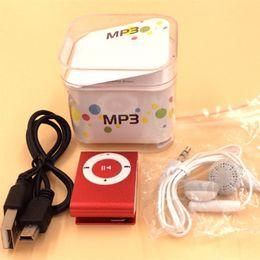 Приходите Оптовая мини Clip MP3-плеер заводской цене с Кристалл коробка наушники USB кабель поддержка TF карт Місогбыл SD карты