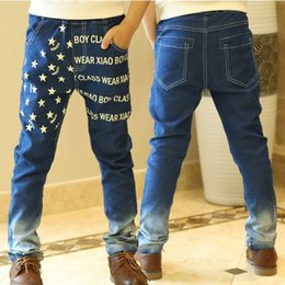 boys printed jeans NZ - 2018 new children boys jeans autumn kids boys spring casual printed stars letters jeans pants 4-9 years !