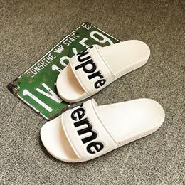 Pantoufles de designer nouvelles lettres de marque Desinger diapositives bascules pour hommes mode estivale nouvelle marée en Solde