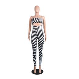 46e8afa7c9553 Black White Contrast Color Striped Fashion Pants Suit Off Shoulder  Strapless Crop Tops Long Skinny Overalls Two Pieces Sets
