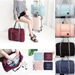 Foldable Flats Wholesale Australia - Folding Travel Storage Bag Carry-On Hand Luggage Organizer Tote Large Foldable Shoulder Duffle Handbags Men Women 5Colors AAA1020