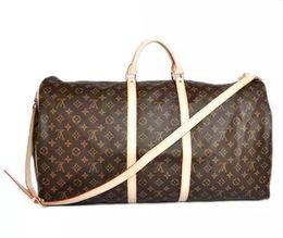 Skull Shaped Glitter UK - high-end luxury men women travel bag Leather duffle bag brand designer luggage handbags large capacity sports bag Tote