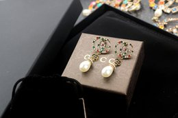 $enCountryForm.capitalKeyWord NZ - jiangyu New arrival Factory Price High Quality Luxury Letter Pearl diamond Stud Earrings Fashion diamond Rivets metal Long earrings With Box