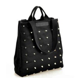 Ladies Punk Handbag NZ - Black Canvas Rivets Casual Tote Women Rock Punk Handbag Fashion Shoulder Bags Messenger Bag Ladies Shopping Bag Large Capacity