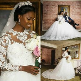 Crystals Applique Bead Wedding Dresses Canada - 2018 New African Ball Gown Wedding Dresses Jewel Neck Long Sleeves Lace Appliques Beads Crystal Court Train Plus Size Formal Bridal Gowns