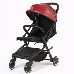 China 2018 New Selling Multi-function Leather Baby Stroller Two-way Four-wheel Safe Shock-proof Anti-skid Foldable Children's Stroller cheap shock wheels suppliers