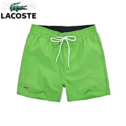 210f886cbc Nueva marca Llegada Verano Pantalones cortos para hombres Deporte Traje de  baño Pantalones cortos Pantalones Tablero Deportes Medio suelto surf Playa  rayada ...