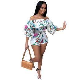 be9e2618874 Floral Print Summer Short Playsuit Women Puff Sleeve Slash Neck Bodycon  Overall Rainbow Vertical Stripe Backless Bodysuit