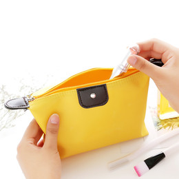 Cosmetic Bags Locks Canada - 2018 Storage Bag Candy-Colored Foldable Dumplings Makeup Bag Simple Girls Zip Lock Fashion Waterproof Washable bags Travel Cosmetic Bags