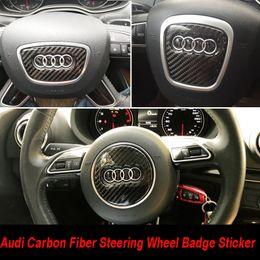 Pelele la etiqueta engomada del volante de la fibra de carbono Insignia Emblema Embellece la cubierta para Audi A1 A3 A4 A5 A6L A7 A8 Q3 Q5 Q7 TT RS en venta