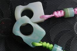 Großhandel NEUER Trend einzelner Fingerring Fluoreszenz spezieller Selbstverteidigungsschlag im Freien Schnalle Überlebenstasche EDC Knöchel Multi coldplay Werkzeuge