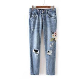 Discount cotton pants fashion women - Fashion Women Floral Embroidery Jeans Denim Pant Ripped Zipper Button Pockets Women Jeans Light Blue Pencil Pants KZ0286