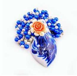 Wholesale Sweet style pearls stone Glass resin flower woman brooches blue simulated pearl lady clothing decorations alloy accessories