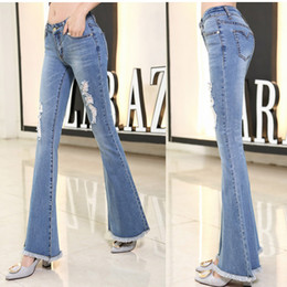 $enCountryForm.capitalKeyWord Canada - Tassel Hole Ripped Flare Jeans Women Long Bell-Bottoms Jeans Stretching For Girls Denim Trousers For Women Large Size
