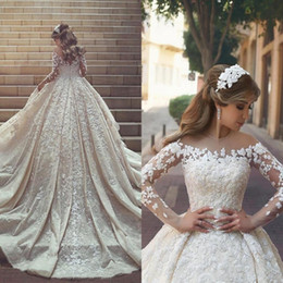 Wholesale 2018 Sexy Sheer Jewel Neck Ball Gown Wedding Dresses Crystals Ruffles Appliques Illusion Long Sleeves Cathedral train Plus Size Bridal Gowns