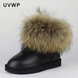 female big boots Canada - Top Fashion Natural Big Fur Gneuine Leather Women Snow Boots Warm Winter Boots Slip-On Ankle Female Raccoon Fur