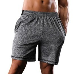 5590cce2ad284 2018 Culturismo Casual Hombres Shorts Cintura elástica Joggers Slim Fit  Shorts Summer Workout Trunks Dry Dry Pantalones deportivos transpirables