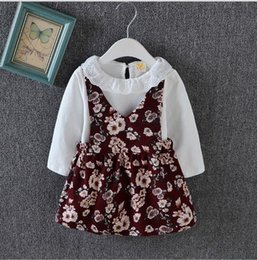 year old child skirt Canada - 0-4 years old baby girl 1 children wear suspenders skirt floral princess skirt long sleeved two piece beautiful spring 2018