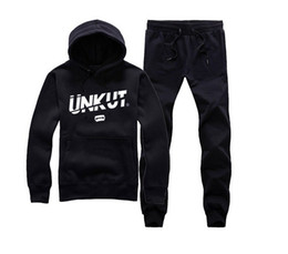 flannel pullover NZ - Men hip hop clothing unkut set hoodie +pants sweatshirt pullover casual streetwear sportswear male famous brand Rock Tracksuits