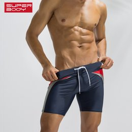 2f9b4756a7 Superbody Brand 2018 men's slippery beach Shorts European and American  fitness sports shorts Swimming Trunks