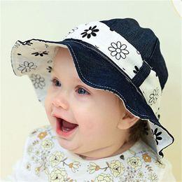 c60232b03caa Baby Summer Outdoor Bucket Hat Children Floral Print Denim Cap Sun Beach Cap  Lovely Lace Princess Baby Girl Brim Sun Hats