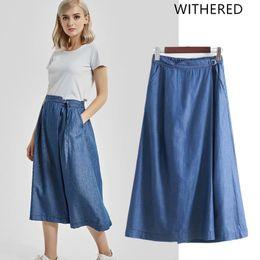 89af0fd0eb Marchita BTS falda mujeres inglaterra estilo denim sólido lazo recto tencel  natural a media pierna faldas womens plus size 2018
