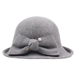 China MISSKY New Women Solid Color Vintage Wool Hat with Bowknot Design Hemming Hat Stylish Felt Cap cheap stylish skull caps suppliers