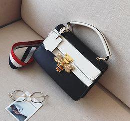 $enCountryForm.capitalKeyWord Canada - New women bee lock single shoulder messenger designer handbags lady fashion evening casual crossbody bags black blue color no546