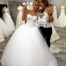 sweetheart ball gown princess wedding dresses NZ - 2019 Princess Puffy Tulle Ball Gown Wedding Dresses Sweetheart Sleeveless Sparkly Sequins Beaded Top Fit and Flare Bridal Gowns with Train