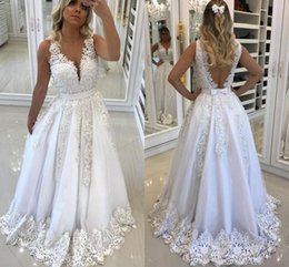 Wholesale Sheer V Neck Beaded Lace A Line Beach Wedding Dresses Hollow Back Wedding Gowns For Brides Appliques Boho Bridal Dresses With Pearls Sash