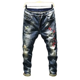 mens printed hip hop jeans Canada - 2018 New Hip Hop Jeans Men Casual Hole Biker Jeans Floral Printed Mens Homme Full Length Pencil Pants Size 36 38