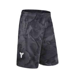 Venta al por mayor de Pantalones cortos de baloncesto de verano para hombres pantalones deportivos para correr bolsillo con cremallera suelta hasta la rodilla transpirable GYM de secado rápido pantalones cortos de tenis